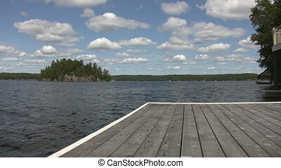 Lake view from cottage dock. - View of island and lake from...
