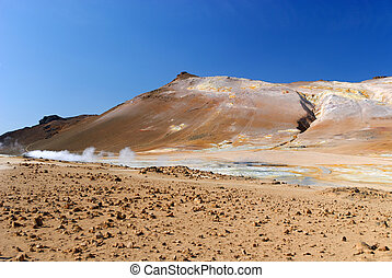 Icelandic landscape in Namafjall - blue sky, red earth and...