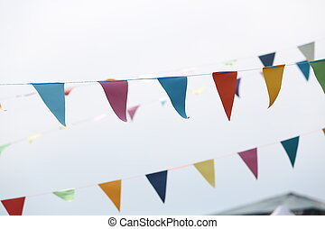 Festive flags on grey background. Close up - Festive...