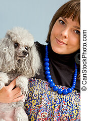 Dog with its master - Photo of grey poodle with its master...