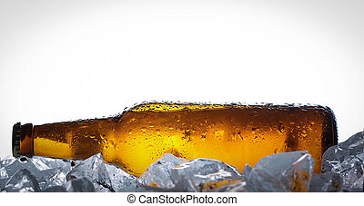 Lying bottle of beer on ice cubes. Close up. White background