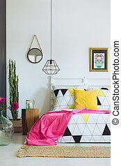 Geometric bedroom design, triangle quilt pattern, pink and...