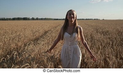 Pretty smiling woman relaxing in wheat field - Pretty...