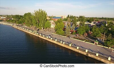 Aerial shot of the Dnipro river and its modern quay covered with greenary