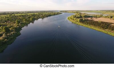 Aerial shot of the Dnipro river and  green riverbanks in a sunny day in summer