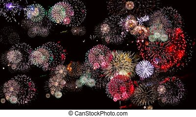 Colorful fireworks at holiday night 4k. Fireworks light up...
