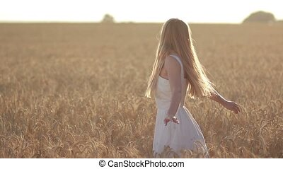 Lovely woman with flying hair in field at sunset - Beautiful...