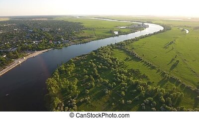 Aerial shot of the Dnipro river curvy line its riverbanks in...