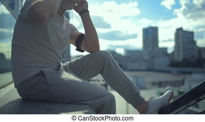 Positive aged sporty man listening to music outdoors - Enjoy...