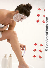 Depilation - Portrait of young female with facial mask...