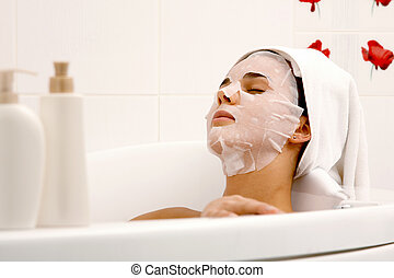 Beauty procedures - Image of serene woman with facial mask...