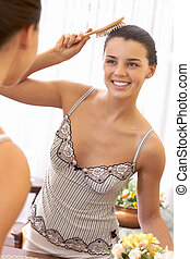 Beauty care - Image of pretty female looking in mirror while...