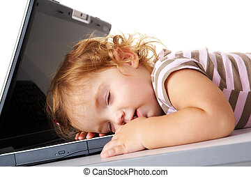 Sleeping with laptop - Cute child sleeping on laptop keypad