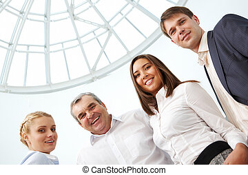 Business partners - Image of confident business team looking...