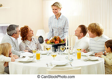 Thanksgiving dinner - Portrait of big family sitting at...