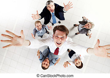 New ceo - Above view of happy chief being thrown by several...