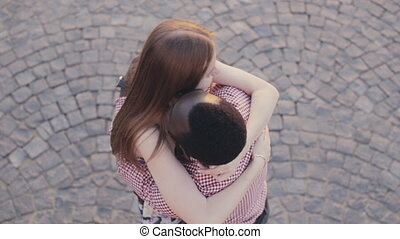 Interracial couple meets and hugs - interracial happy couple...