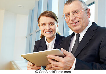 Leader - Senior business leader with happy businesswomen on...