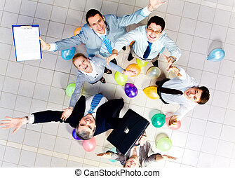 Having fun - Above view of joyful business people looking at...