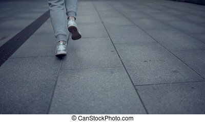 Tracking shot of a sporty fit man running - Urban life....
