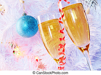 Celebration - Two champagne flutes with firtree branch...