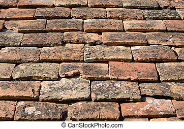 Old roof tiles on a stone building