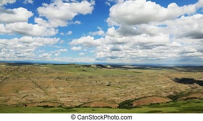Timelapse view of the highland valley from the height of the...