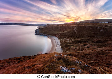 Tor Bay sunset - Sunset over Tor Bay and Penmaen village on...