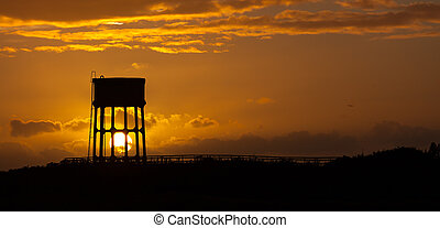 The Water tower at Sandy Lane - Sunset behind a water tower...