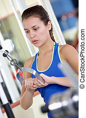 Exercise - Photo of active girl pumping muscles on special...