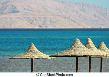 Umbrellas, Mount and Red Sea - Umbrellas and Red Sea on...