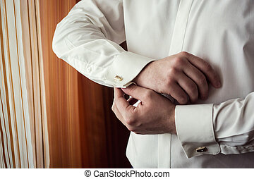Businessman dress shirt. The man in the white shirt in the...