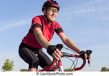 Cycling Concepts. Smiling Professional Road Cyclist During...