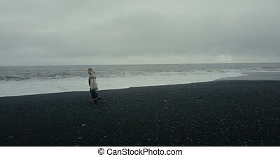 Copter flying around young couple in icelandic sweater...