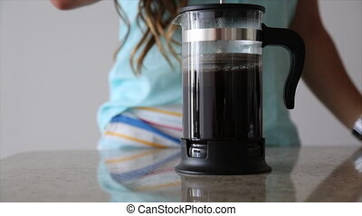 Female making fresh coffee french press - Morning hot coffee...