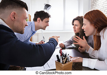 Business Coworker Arguing To Each Other At Workplace In...