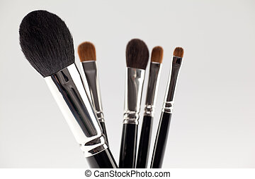 a detail of a 5 brushes make-up set.