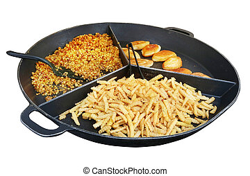 Street fast food- French fries,  soared peas and fried pork  pies on a big frying pan.