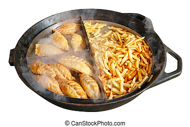 Street fast food- French fries and fried beef and chicken pies on a big frying pan