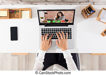 Elevated View Of Businessperson Videoconferencing On Laptop...