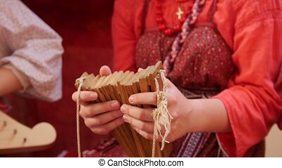 Russian folk music ensemble - woman beats the rhythm of the...