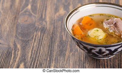 uzbek soup on wooden table - Tasty uzbek soup on wooden...