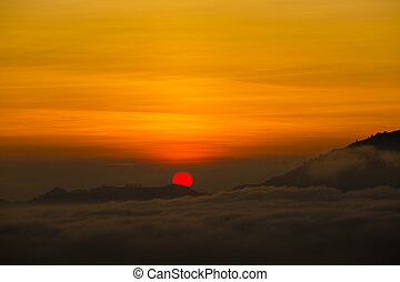 Scenic sunrise and mist at Batur volcano, Kintamani, Bali,...