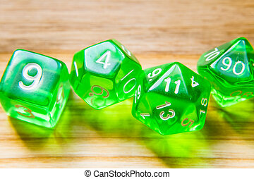 A lot of translucent green playing dice on a wooden...