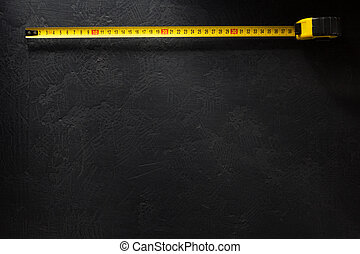 tape measure  on black backgraund