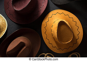 cowboy hat on wooden background - cowboy hat on black wooden...
