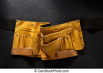 tool belt on black background