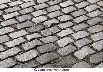 Cobblestone background abstract. Granite cobbles. Old street...
