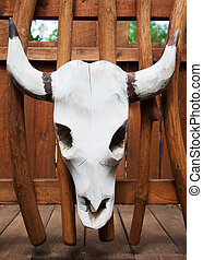 Cow skull carved from wood.