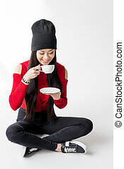 attractive asian woman holding tea cup isolated on grey